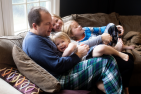 a new jersey family snuggles on their living room couch