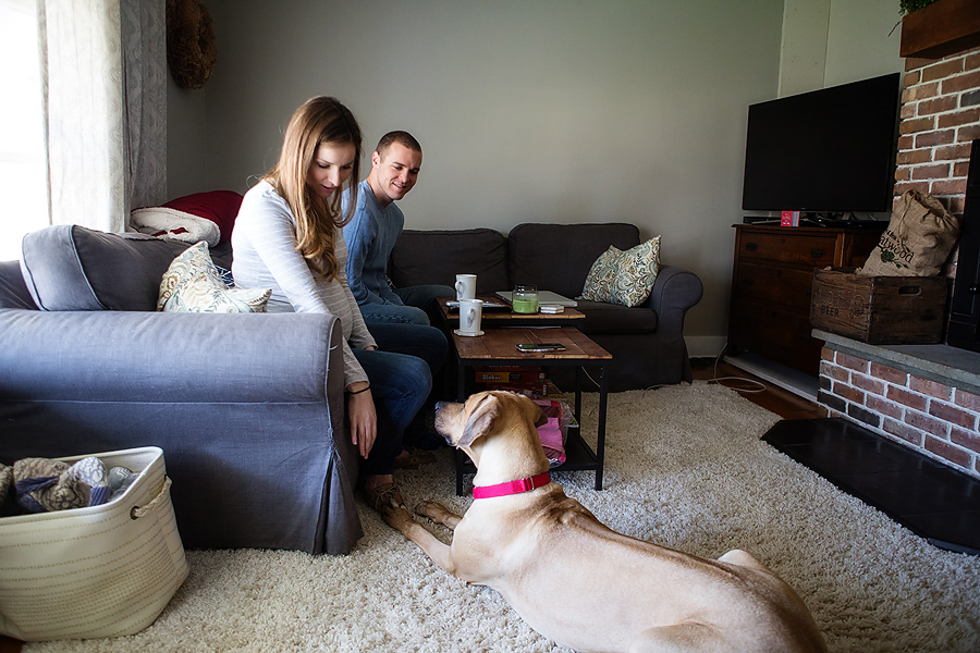 A New Jersey couple expecting their first baby has a documentary maternity photo session in their home and a park near their house, with their cat and dog, while they get their daughter's nursery ready for her arrival and go for a hike in the woods and by the river.